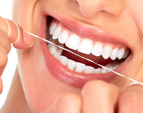 beautiful smile women flossing