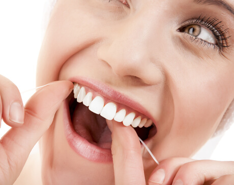 beautiful women flossing hove dental