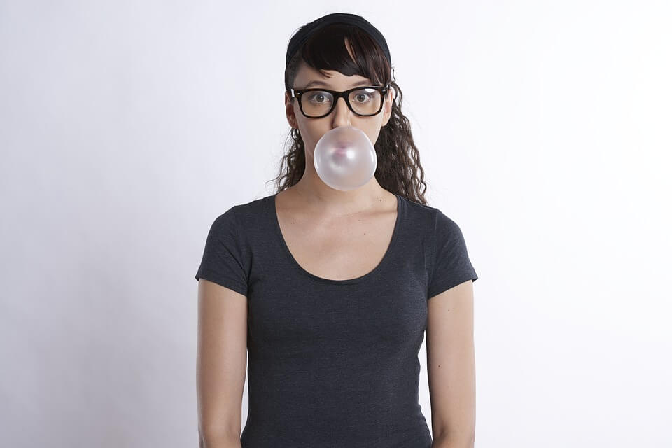 Woman blowing bubblegum bubbles