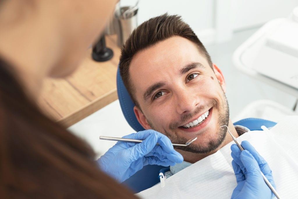 A Man Having A Visit At The Dentist's